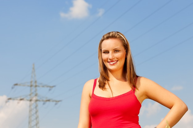 Woman standing in front of power pole