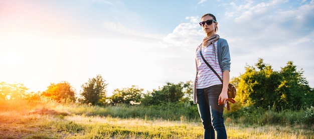 Woman standing on a meadow