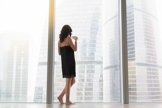 Woman standing near the window