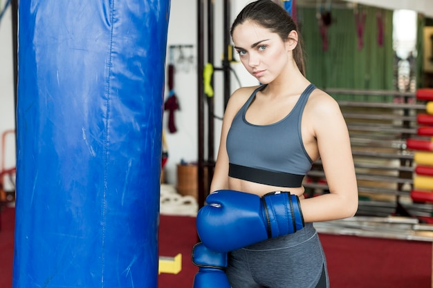 Woman standing at punch bag
