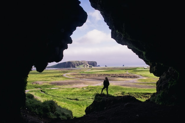 Woman standing on rock formation during daytime