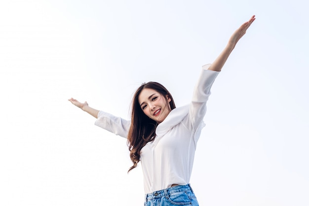 Woman standing stretch her arms relax and enjoy