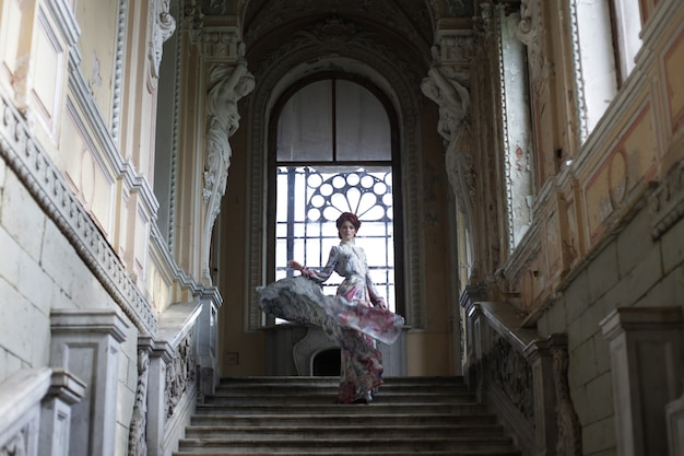 Woman standing on the top of a stairway