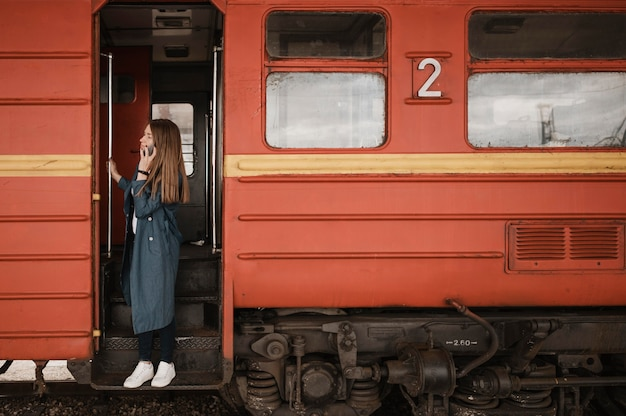 Woman standing in the train entrance and looking for someone