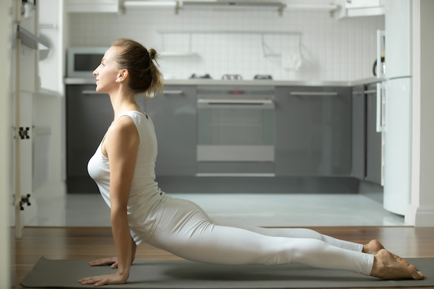 Woman standing in upward facing dog exercise