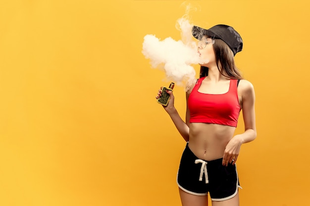 Woman standing and vaping