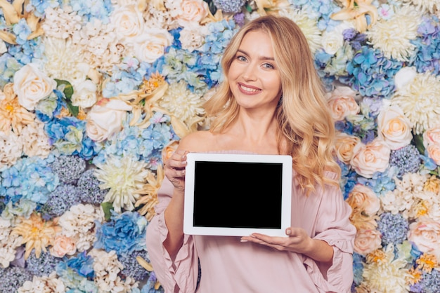 Woman standing with blank tablet
