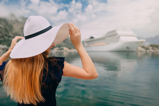 Woman stands on cruise liner background