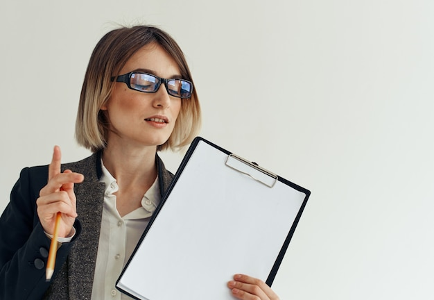 Woman stationery folder documents white sheet of paper