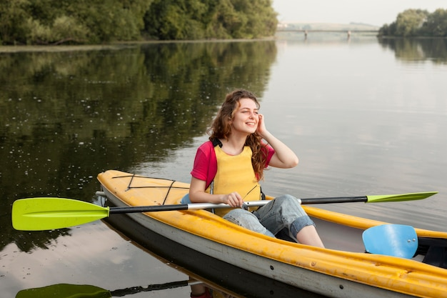 Woman staying in kayak and smiling
