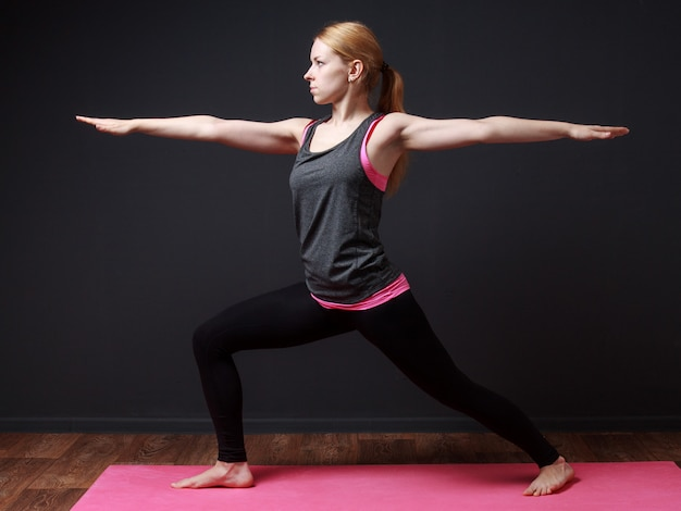 Woman staying in warrior pose
