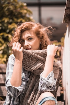 Woman on steps holding scarf