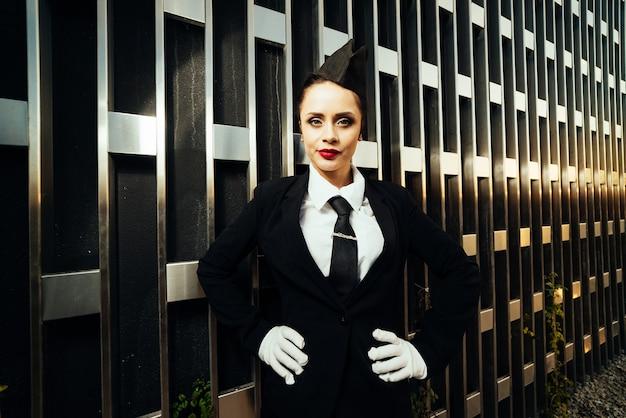 Woman stewardess in uniform posing at camera