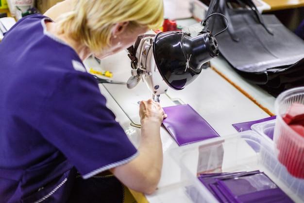 Woman stitching a purse