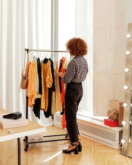 Woman in store trying on clothes