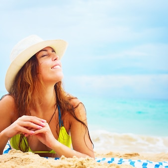 Woman straw hat lying sand summer vacation