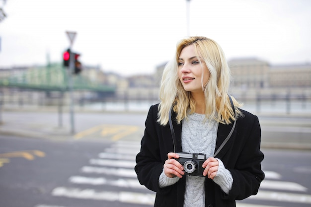 Woman in the street doing photos