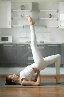 Woman stretching in bridge exercise