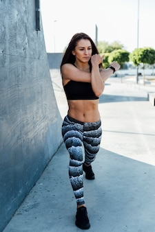 Woman stretching and doing lunges