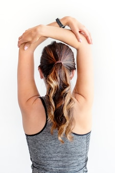 Woman stretching her arms before workout