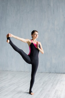 Woman stretching her leg while standing
