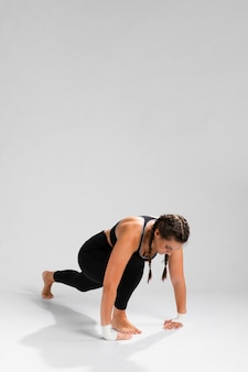 Woman stretching with copy space background