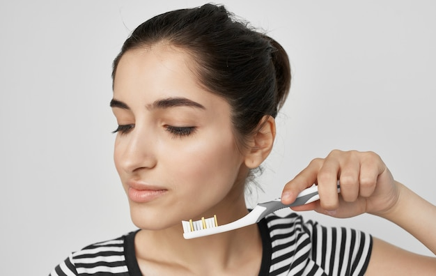 Woman in striped t-shirt toothbrush oral hygiene health