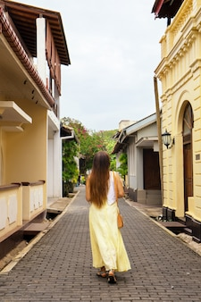 A woman strolls through the city of halle