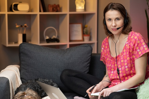 Woman student wear headphone study online with internet teacher learn language.