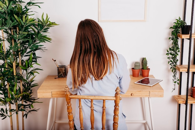 Woman studying alone at table