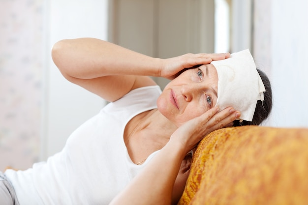 Woman stupes  towel to her head