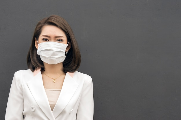 Woman suffer from sick and wearing face mask., asian woman in protective mask feeling bad