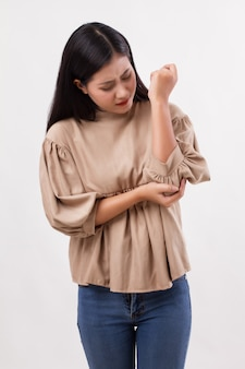 Woman suffering from elbow joint pain, rheumatoid or gout arthritis
