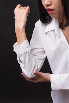 팔꿈치 관절 통증, 류마티스 또는 통풍 관절염으로 고통받는 여성