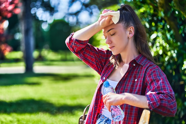 Woman suffering from hot weather
