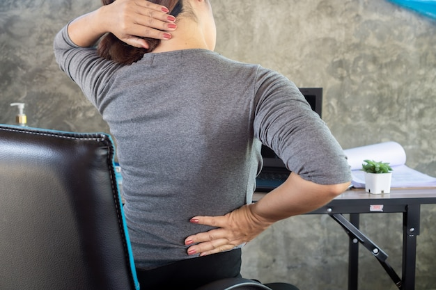 Woman suffering from lower back pain