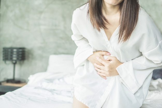 Woman suffering from stomach pain during period