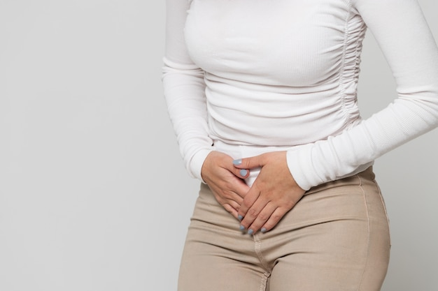 Woman suffering from stomach pain, feeling abdominal pain or cramps.period menstruation