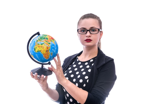 Woman in suit holding globe isolated on white wall