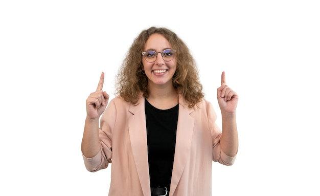 Woman in suit pointing up with her two hands isolated on white