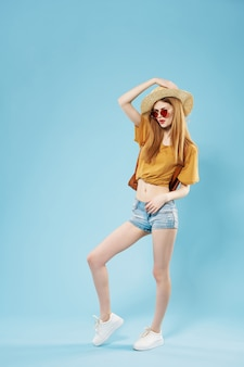 Woman in summer clothes hat sunglasses travel full length