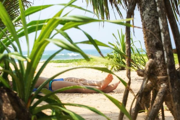 Woman sunbathing near the ocean