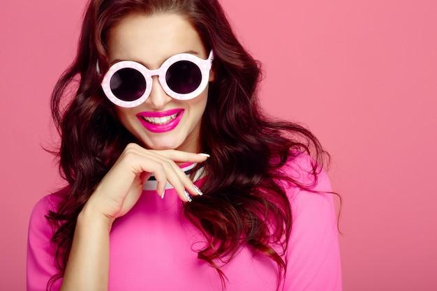 Woman in sunglasses close-up, studio