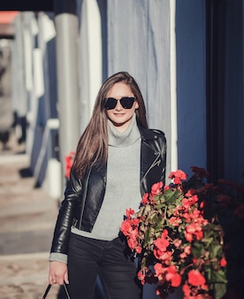 Woman in sunglasses and leather jacket