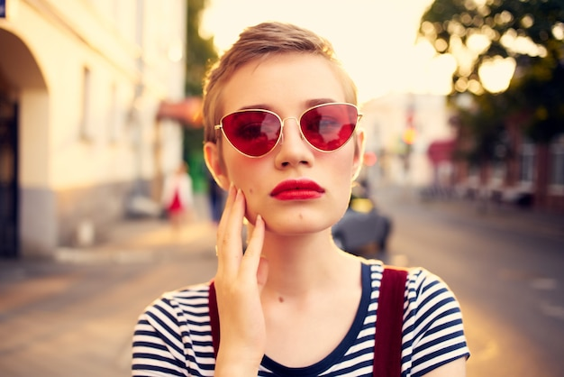 Woman in sunglasses with short hair outdoors romance posing