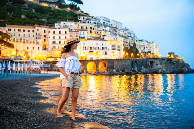 Woman on sunset in amalfi town in italy