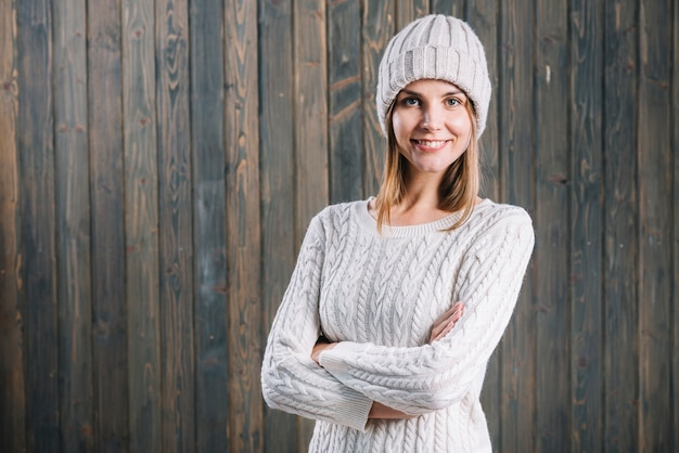 Woman in sweater crossing arms on chest