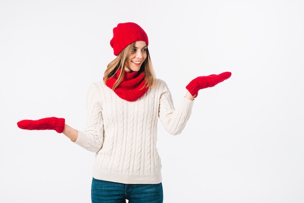 Woman in sweater holding hands apart
