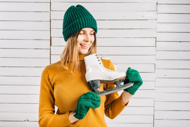 Woman in sweater looking at skates
