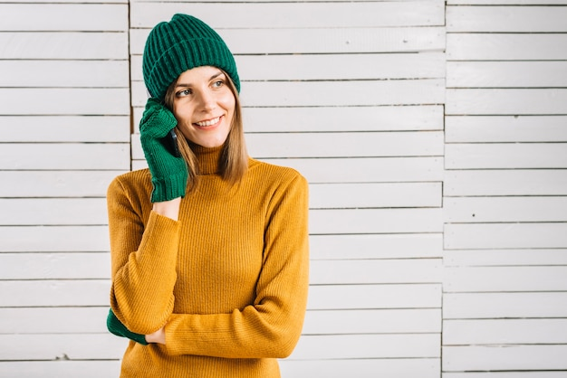 Woman in sweater talking by phone